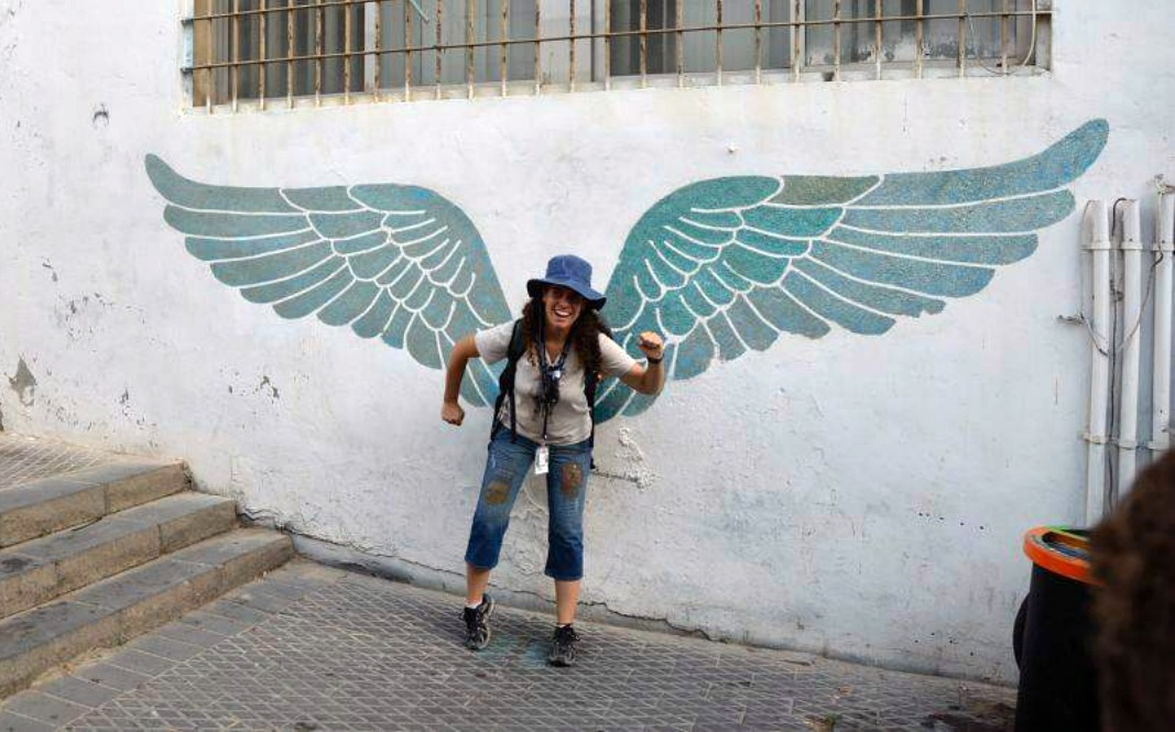 Posing with a set of wings set up as street art in Old Jaffa