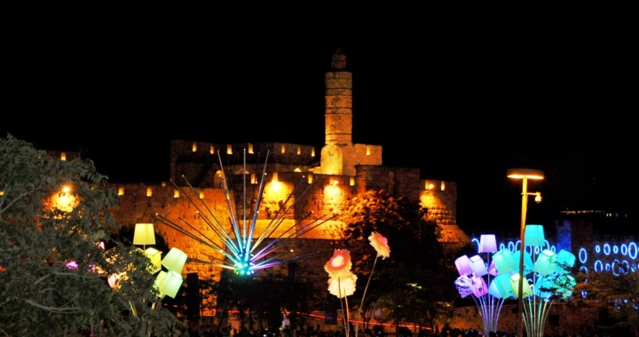A view of Jaffa Gate and the Tower of David, all lit up with art installations that resemble a garden, at the Jerusalem Light Festival