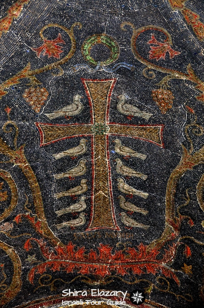 Mosaic of a Salus Mundi style cross, with a face in the middle and 12 white doves on Calvary Hill, 11th Station of the Cross