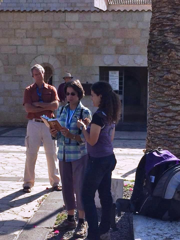 Guiding a Bible reading outside the Church of the Multiplication of the Loaves and the Fish