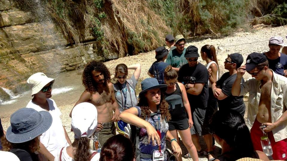 Guiding Shai's Birthright group in front of a waterfall