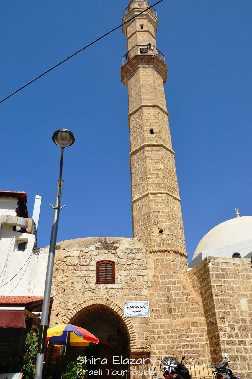 An ornate door and the minaret of the Mahmudia Mosque in Jaffa